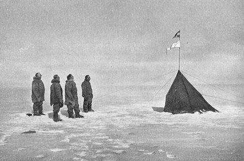 Roald Amundsen at the South Pole with his crew. Norwegian flag flying proud.